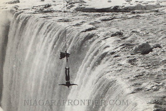 On February 7th 1975, an unidentified man (Mr. X) working for a Toronto film company was dangled over the precipice of the Horseshoe Falls at the Table Rock by a crane for five minutes while strapped into a strait jacket.